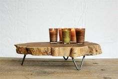 Showcasing a table that features unique design. Raw edged wood slab top is supported by durable metal feet. This table is one of its kind. TableConstruction Material: Wood and MetalRaw Edged Wood Slab