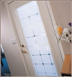 Might want to do this on the bottom half of our new patio doors.  Monte Carlo Etched Glass Film Semi-Private