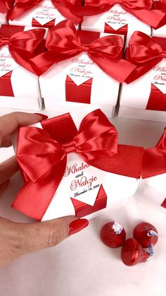 Red wedding favor gift boxes with satin ribbon bow and names, Elegant personalized bonbonniere for candies or small souvenirs to thank guests. #welcomebox #giftbox #personalizedgifts #weddingfavor #weddingbox #weddingfavorideas #bonbonniere #weddingparty #sweetlove #favorboxes #candybox #elegantwedding #partyfavor #weddingwelcome #redwedding #uniqueweddingfavors #uniqueweddingideas Handmade Wedding Favours, Beach Wedding Favors, Wedding Favor Boxes, Wedding Gifts, Personalised Box, Personalized Gifts, Red Wedding, Elegant Wedding, Wedding Welcome