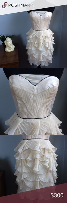 BCBG Short Strapless Chiffon Dress Stunning! Brand new BCBG runway dress. Never been worn. No visible signs of damage. Gorgeous cream color, with a corset top and tiered layered bottom. Would make a great prom, party or wedding dress. BCBGMaxAzria Dresses Mini