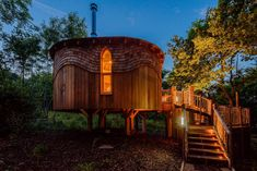 Woodside Bay: An Isle of Wight treehouse hideaway with red squirrels, log burner and a hot tub - Country Life Newport Isle Of Wight, Tree House Accommodation, Bay Lodge, Log Burner, Logs, Aerial View, Country Life, Outdoor Structures, Places