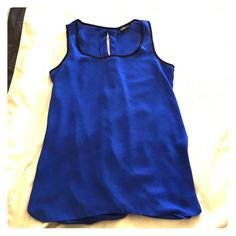 Split back bright blue tank! Beautiful blue tank with a split open back (closes at the bottom so not too much back is exposed). Express Tops Blouses