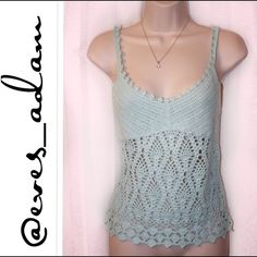 Light Aqua/mint colored crochet knit tank top This top is AMAZING!!!! I am only selling because I lost weight and it no longer fits me. In fact, it is brand new and still has the hanging plastic barb, just not the tag. I put as NWT because of the hanging plastic barb. This is a hand knit and from Express. Perfect for the upcoming Spring and summer. 55% ramie, 45% cotton. Get it quick!!!! Fits in between a crop top and shorter length top. Express Tops