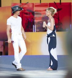 Tim McGraw and Faith Hill I love her hair and outfit!!