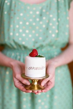 Brides.com: . Individual wedding cakes topped with fresh raspberries and decorated with calligraphy names, created by Cakes by Chloe.