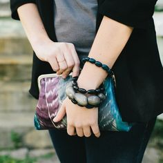 Obsessed with this feather motiff. Made from remnants, only 2 made.  #tagua #feathers #clutch #fashion #handbag #style