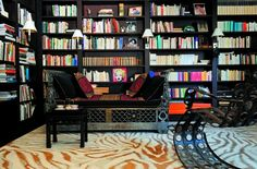 Diane von Furstenberg's Paris Apartment - love the dark contrasted with the colourful book spines