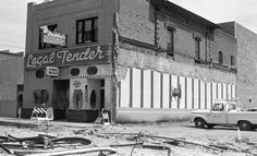 "The Legal Tender on West Congress before demolition in July, 1969. Workers also tore up old trolley tracks in the street. Bonnie Henry wrote, ""Though his bar was leased out to others in the 1960s, Eduardo Jacobs passionately fought what he saw as its coming destruction."""