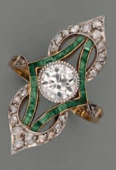 An Art Nouveau gold, silver, diamond and emerald ring. #ArtNouveau #ring