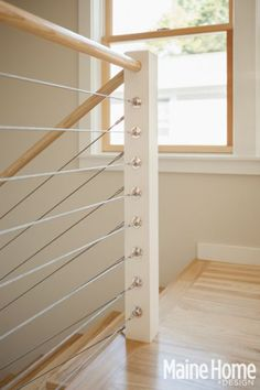 Railing combines wood and cables.