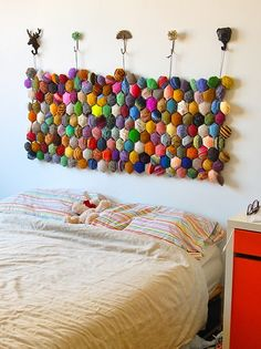 What an excellent way to use up yarn scraps. Super creative and super decorative!  ----  Hexipuff Headboard Wallhanging - Beekeepers Quilt from Tiny Owl Knits    GENIUS