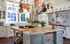 just love this kitchen.  the island with the open butcher block and side 'storage'...just perfect