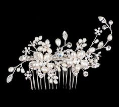 Elegant Pearl & Rhinestone Hair Comb by Bridal Accessories Outlet ~ $59.00 ~ Bridal Accessories Outlet is your one stop shop for the finest in affordable designer quality wedding accessories and jewelry at discount prices.  Inexpensive but never cheap hair combs, flowers, tiaras, birdcage, short and long veils, earrings, belts, jewelry, bracelets, hair pins, shoe clips, bustle clips and more for the bride and bridesmaids.  Bridal Accessories Outlet is a division of Hair Comes the Bride, Inc.