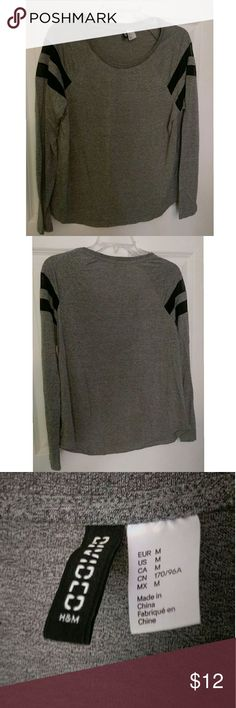 H&M Gray Sport Long Sleeve Top Shirt Very good condition H&M gray work out long sleeve top. No damage/stains, and worn once.   From a smoke free home. What you see is what you get. Please NO trades, PayPal, other sites, or holds. New = Condition. I ship same or next day. Don't like the price? Make me an offer! Serious buyers only. Thank you. H&M Tops Tees - Long Sleeve