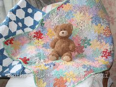 "Cathi made this baby quilt using the other half 1"" 60-degree hexagon collection."