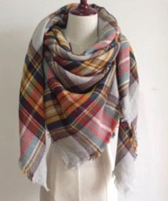 This extra soft scarf is perfect to keep you warm and stylish the whole water and fall season. This scarf is plaid with beautiful fall colors. Size: 55 inches by 55 inches
