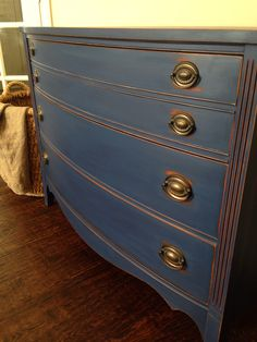 Annie Sloan's Napoleonic blue. I lightly distressed the edges on this beautiful antique dresser. Painted by @jaimea4