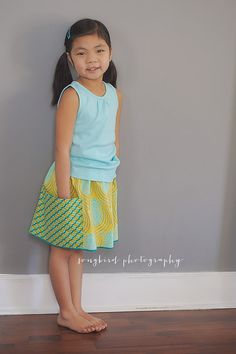 She will love to twirl in this aqua and by GenerationsInStyle, $27.00
