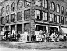 Supplies piled on the sidewalk in front of the John B. Agen store on Western Avenue. Univ. of Washington Libraries, special collection SEA1335