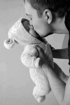 The closed eyes in this squash-face kiss and the teddy ears make this shot. Cute Daddy-baby b/w portrait.