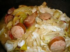 "Kielbasa, Cabbage, and Onions in Crock Pot  								From The Everyday Low-Carb Slow Cooker Cookbook by Kitty Broihier & Kimberly Mayone.  ""These flavors may remind you of something your grandmother used to cook.  A great dish for a simple fall supper.""  Serving suggestion - Serve this dish with toasted, buttered, low-carb rye bread.  If desired, pass malt vinegar and butter to season the cabbage."
