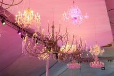 """The  Lincoln Park Zoo  in Chicago gave its annual summertime ball a """"Great Cats-by"""" theme this year. To channel the interior of a grand East Coast estate described in F. Scott Fitzgerald's novel,  Frost 's David Kelly worked with designers from  Event Creative  to hang a cluster of ornate chandeliers form the top of the dinner tent."""