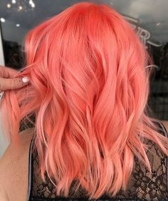 Bright peach pink or Scarlet pink or strawberry pink hair color idea for wavy short hair. I love the color! Just don't know the right name :)