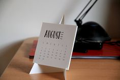 2015 Printable Monthly Calendar    Make your very own desk calendar! It features a simple typographic b/w design and you get a template for the