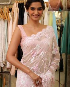 Sonam Kapoor Soft pink sari with heavy thread embroidery   1. Pastel pink net sari with heavy thread embroidery and sequins highlight2. Comes with a matching raw silk blouseFabrics:- Saree : Net, Blouse: Rawsilk
