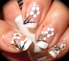 Image on Designs Next  http://www.designsnext.com/beauty/nail-art-designs/25-white-nail-art-designs.html