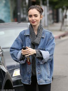 Retro outerwear: The brunette beauty was wearing a denim jacket more fitting in her famous father Phil Collins' eighties hey-day