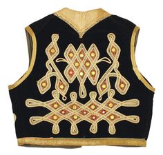 Jimi Hendrix's owned and worn black velvet vest beautifully embroidered and decorated with tiny mirrors on the front and back.  #Jimi #Hendrix #vintageclothes #1960s #1970s