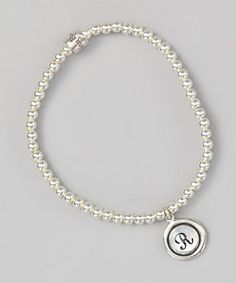 I really love this pearl and silver charm, initial bracelet. I love to give them to new Mommies, with the initial being that of the new little one. But, it's also good for Grandmothers', daughters.,,anyone whos proud of who they are.