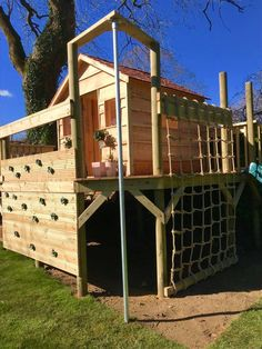 Treehouse bespoke design With climbing wall, firemans pole, scramble net and treehouse