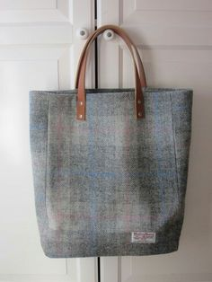 3b0b690542cd Established Scottish online shop offering a range of luxurious Harris Tweed  accessories and gifts. We specialise in handbags