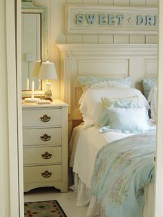 Cottage bedroom; DIY headboard from a 5 panel door, add trim.
