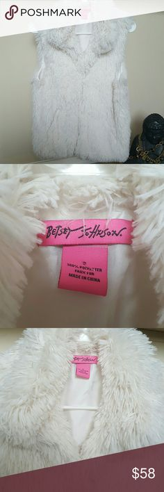 "Betsey Johnson vegan soft furry white vest Small Right on trend is Betsey Johnson white furry polyester vegan friendly soft must have versatile vest.  Fully lined in great condition w 2 slash side front pockets,invisible but they are there.....Collared down front....great look  SMALL Approximately 18 1/4"" underarm to underarm when class closed by two front hooks..23 3/4"" from top of shoulder to bottom edge. Betsey Johnson Jackets & Coats Vests"