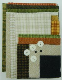 "March - Lucky Charmer (Fabric Pack) Little Quilts Squared - Calendar Series Included in your pack: three cream fabrics for background, orange herringbone for binding and applique, assorted fabrics for applique pieces, cotton print for backing and buttons. You'll need the pattern ""Little Quilts Squared - March"" (A32909)."