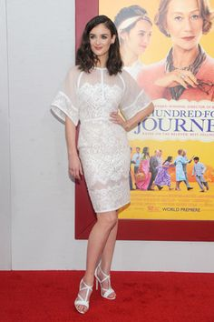 "Charlotte Le Bon posed in a sheer, lace-paneled white Elie Saab frock from the designer's <a href=""/fashionshows/review/2014PF-ESAAB"" target=""_blank"">Pre-Fall '14</a> collection at the New York premiere of her new film, <em>The Hundred-Foot Journey</em>."