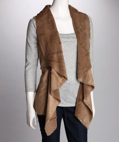 Enhance an ensemble by slipping on this chic vest. A soft vegan leather and faux fur silhouette flaunts cruelty-free style while the super-soft lining adds comfortable coziness.Measurements (size S): 20'' long from high point of shoulder to hem100% polyesterDry cleanImported...