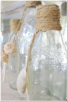 Countdown to Summer Party… Shells & Twine Empty grenadine bottles, shells and cords make sweet summer decoration bottles Seashell Projects, Seashell Crafts, Beach Crafts, Diy And Crafts, Twine Bottles, Vintage Bottles, Bottles And Jars, Wrapped Bottles, Glass Bottles