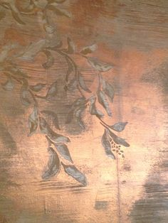Close up of raised stencil with Modern Masters Metallic plaster and bronze foil. By Tracy Wade Design, LLC.