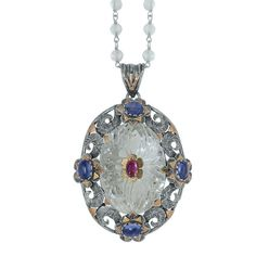 This stunning one of a kind pendant has been handmade in our workshops. It features a large hand etched crystal,  which is embedded with a central ruby set in 18ct gold. On the outside of the crystal we have used a mix of  oxidized silver and 18ct gold hand engraved motifs, which are embedded with kyanites.  The pendant comes with an 18 inch crystal and oxidized sterling silver chain.  Dimensions - 60mm from top of pendant hook x 40mm wide. Oxidized Sterling Silver, Sterling Silver Chains, Alternative Wedding Jewellery, Gold Hands, Hand Engraving, Precious Metals, 18k Gold, Pendant Necklace, Jewels