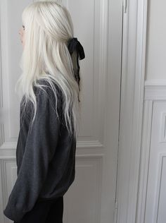 ultra blonde hair - turn a whiter shade of pale, tie it with a black bow.