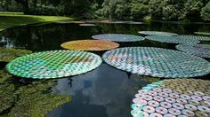 Upcycled cds turned into pond lilies  http://www.bitrebels.com/design/upcycled-cd-art-project/?=v1