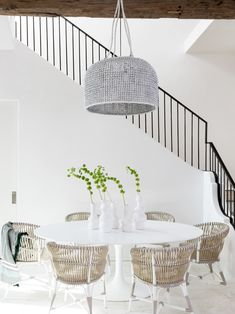 Modern minimal white dining room design with wicker chairs and Saarinen table on Thou Swell White Wicker Chair, Wicker Dining Chairs, White Dining Room Chairs, Black Chairs, Dining Furniture, Beach Dining Room, Dining Room Design, Dining Rooms, White Dining Set