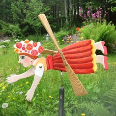 Artisan Whirligig Flying Happy Girl is the original product, 100% handmade and created by the famous russian artist Elena Orlova (visit the website