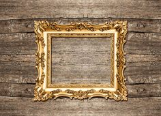 Golden frame on wooden background by LiliGraphie on Creative Market