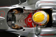 "British Formula 1 driver Lewis Hamilton posed with a new helmet at the McLaren Technology Centre in Chertsey, England. The helmet has a diamond-encrusted ""1″ and will be worn by Hamilton at the Monaco Grand Prix, 2009"