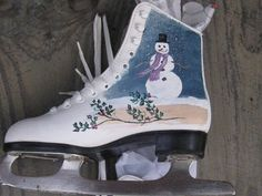 Up-cycled, hand-painted Ice Skates will add country charm to your home or cottage. A winter scene with a small church on one skate and a snowman